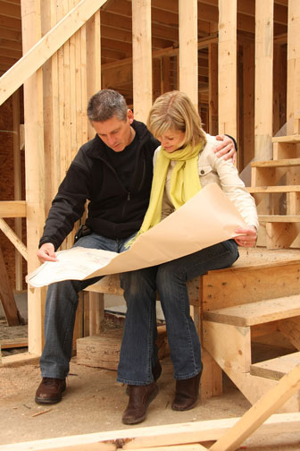 couple reviewing home construction plans