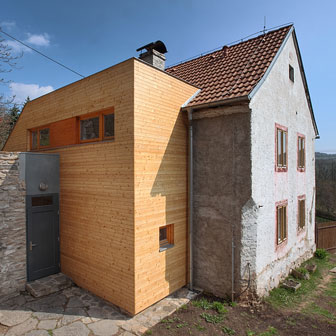 wood addition on a traditional rustic house